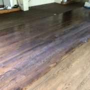 Applying sealer to Red Oak flooring