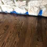 Finished Red Oak flooring - fireplace detail