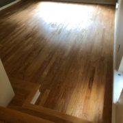 Popped grain, sanded Red Oak flooring