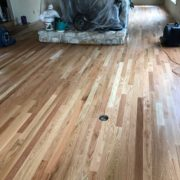 Popping grain of sanded Red Oak flooring