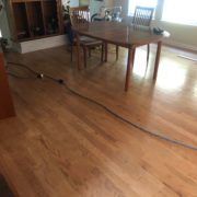 Prior to sanding, staining and refinishing the existing wood floors.