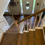 Stained, finished Red Oak floor, stair treads and rail