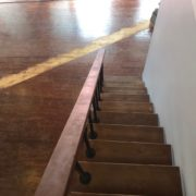 View from stairs- sanding Southern Yellow Pine plank flooring