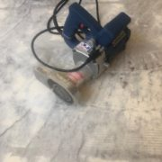 grinder used in leveling slab for wood flooring installation