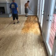 Popping the sanded wood flooring grain