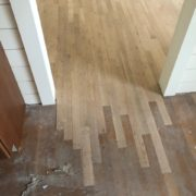 Weave in unfinished white oak flooring at doorway
