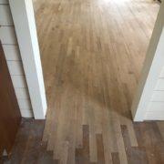 Weave in unfinished white oak flooring at doorway and installation