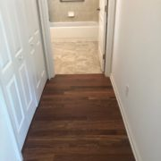 Emser porcelain floor tile and Caribbean rosewood flooring - installed