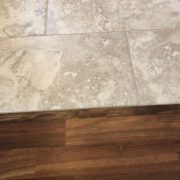 Caribbean rosewood transition to Emser porcelain floor tile