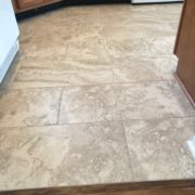 Caribbean rosewood transition to Emser porcelain kitchen floor tile