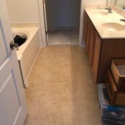 Emser porcelain floor tile installed in one of the bathrooms