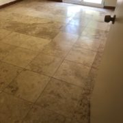 Existing tile floor, prior to diamond grinder leveling