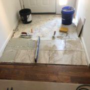Installing Emser porcelain floor tile - foyer