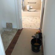 Installing Emser porcelain floor tile - laundry area