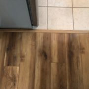Luxury Vinyl Plank flooring transition to existing tile