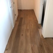 Installing engineered White Oak hardwood flooring.