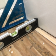 Leveling stair treads with shims.