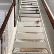 Progress installing Brazilian Cherry stair treads.