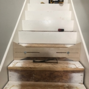 Using template to measure for new stair risers