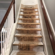 Using template to measure and installing new stair risers