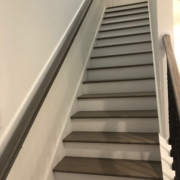 Stained and finished gray stair treads and rails