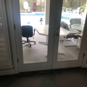Leveled concrete slab subfloor - view of patio & pool