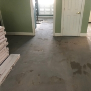 Leveled concrete slab subfloor