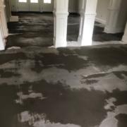 Leveling concrete slab floor