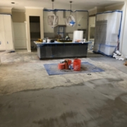 Leveled concrete slab subfloor, prior to wood flooring install