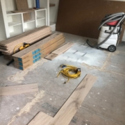 Leveled sheet plywood subfloor