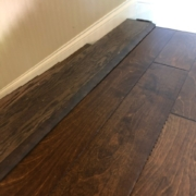 Installed birch hardwood flooring - top of the stairs