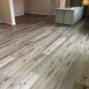 "9"" wide, gray, Luxury Vinyl Plank - installed."