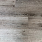 "9"" wide, gray, Luxury Vinyl Plank - installed detail."