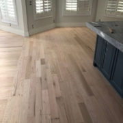 Sanded, hand scraped Red Oak floors.