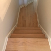 Sanded, hand scraped Red Oak floors and stair treads.