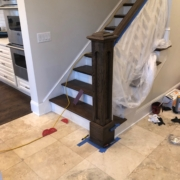 Staining the newel post and hand railing.