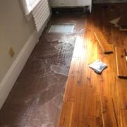 Installing solid Acacia wood flooring.