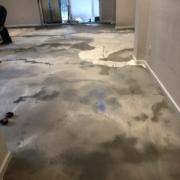 Leveling concrete slab subfloor.