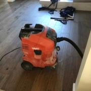 Removing bathroom flooring.