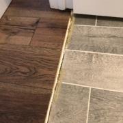 Transition to old bathroom flooring.
