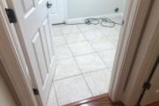 White tile laundry room floor.