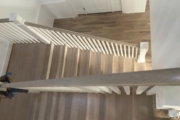 Finished Oak stairs and solid White Oak flooring.