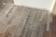 Sanding solid White Oak flooring.