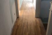 Sanding solid White Oak flooring.