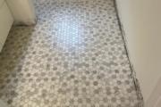Installed Lungarra Carrara tile.