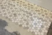 Installing Lungarra Carrara tile.