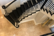 Finished, matte black painted stairway.