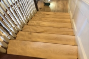 Sanding the staircase.