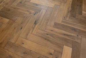 French Oak flooring installed in herringbone pattern.