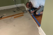 Cutting old wood flooring square.